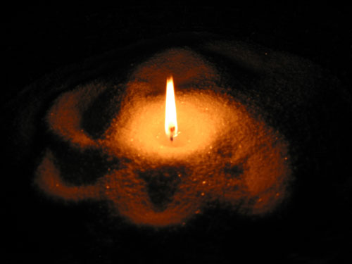 Candle in sand